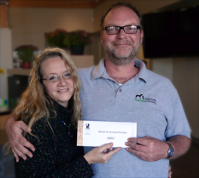 Amy White Presents Check to Asheville Humane Society